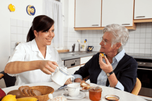 caregiver preparing meals for her patient